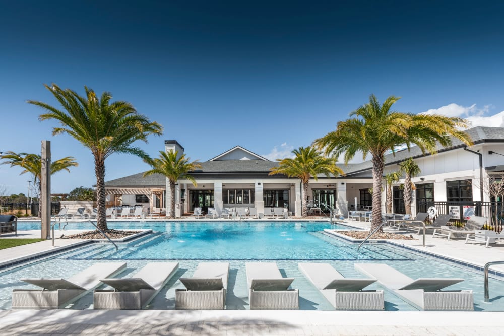 A luxury swimming pool at Olympus Emerald Coast in Destin, Florida