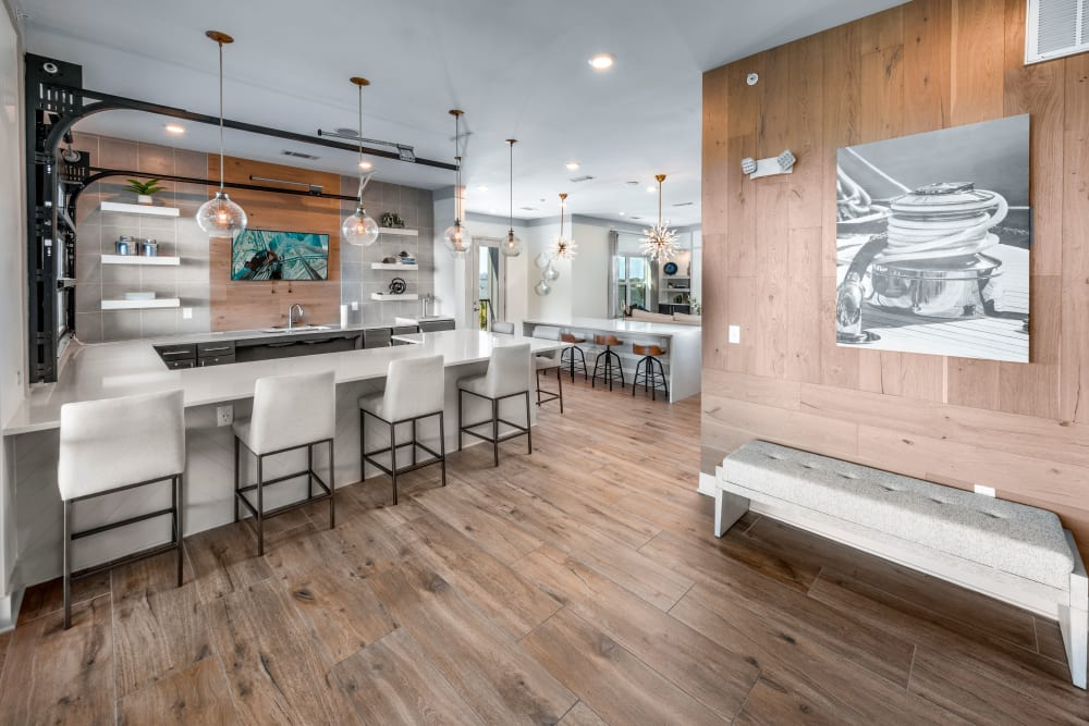 A clubhouse with wood-style flooring at Olympus Emerald Coast in Destin, Florida