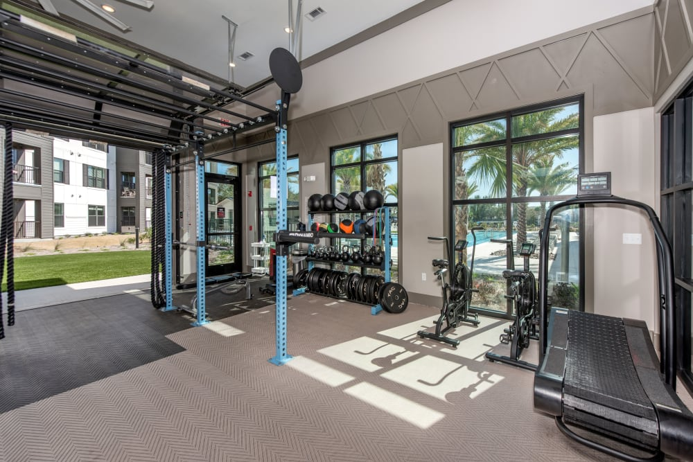 A fitness center with a weight rack at Olympus Emerald Coast in Destin, Florida