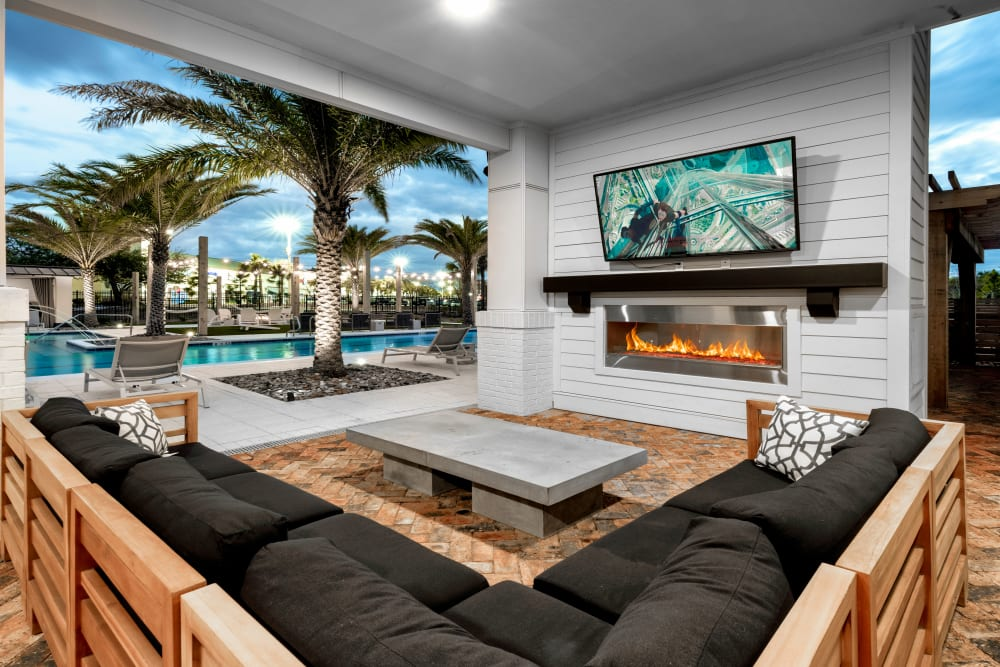 An outdoor lounge with a fireplace at Olympus Emerald Coast in Destin, Florida