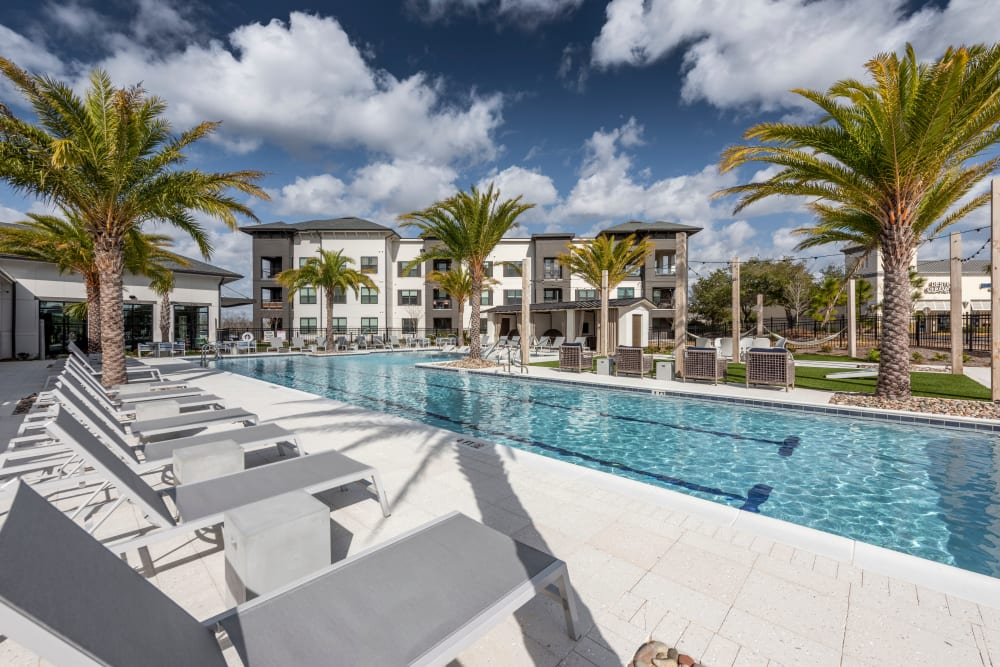 Plenty of poolside lounge chairs for entertaining guests at Olympus Emerald Coast in Destin, Florida