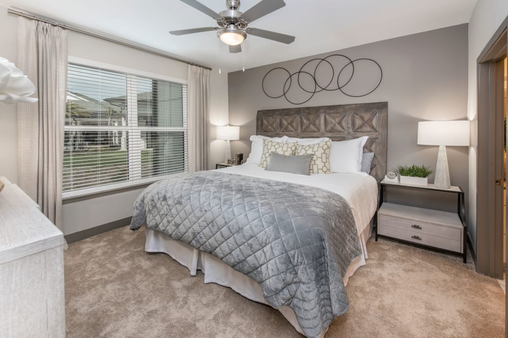 A beautiful master bedroom in a model home at Olympus Emerald Coast in Destin, Florida
