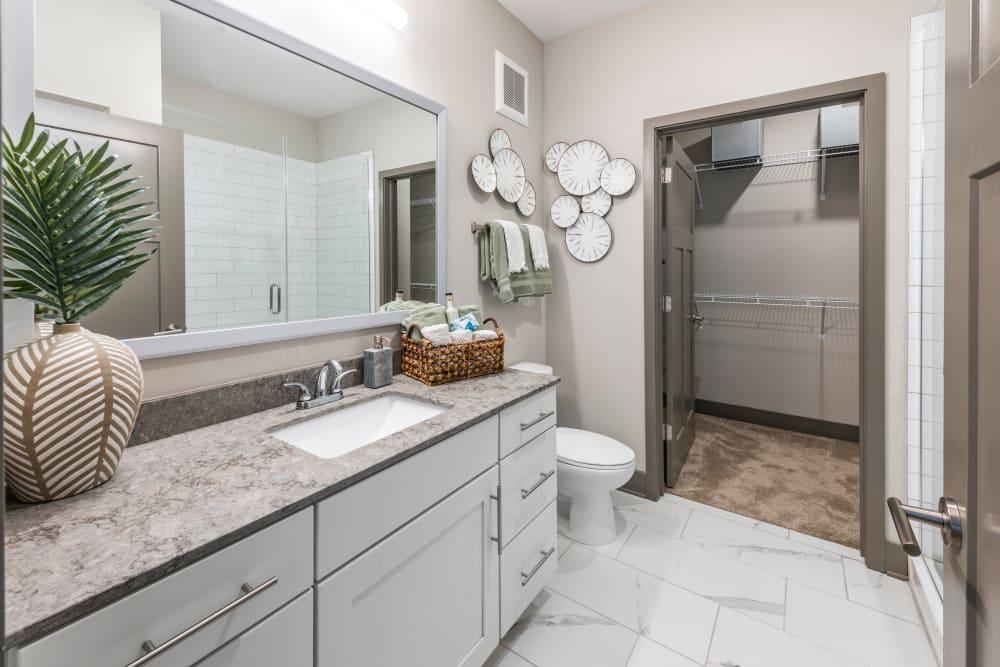 A large bathroom vanity with plenty of storage at Olympus Emerald Coast in Destin, Florida