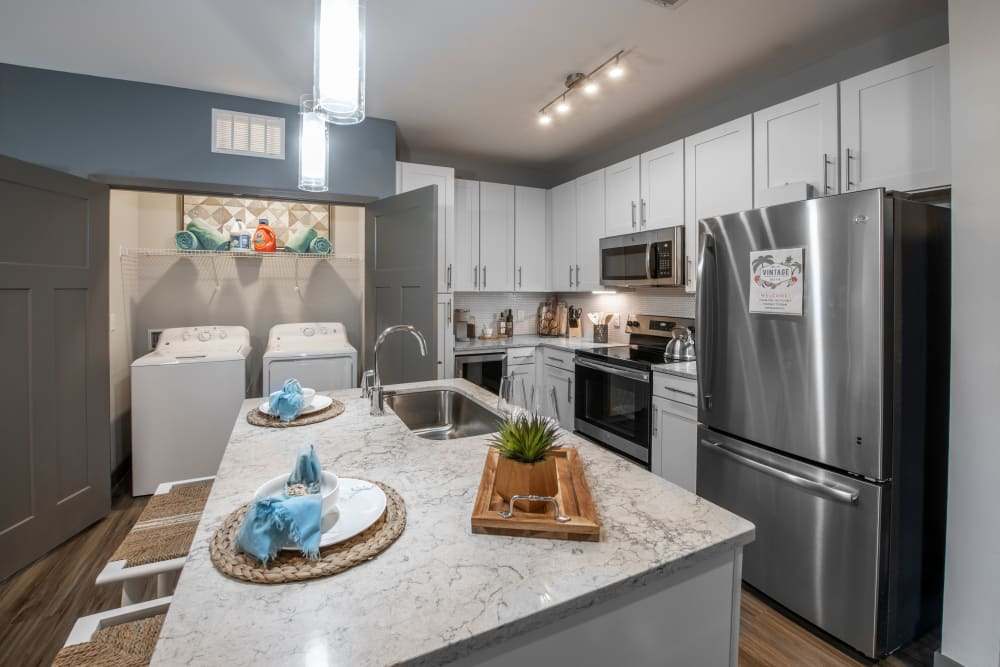 A kitchen with a microwave at Olympus Emerald Coast in Destin, Florida