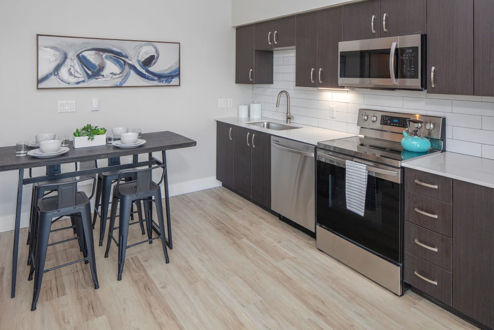 Kitchen table and appliances at Brookside Apartments