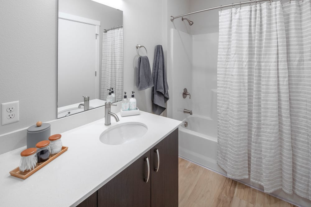 Sparkling bathroom sink and shower in Gresham, OR at Brookside Apartments