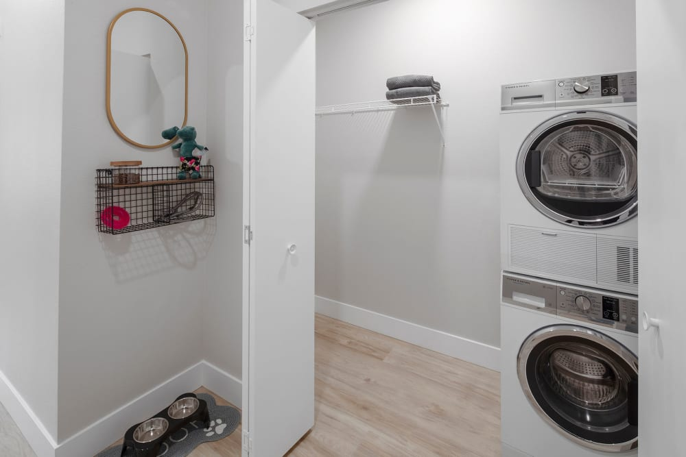 Stacked washer and dryer closet at Brookside Apartments