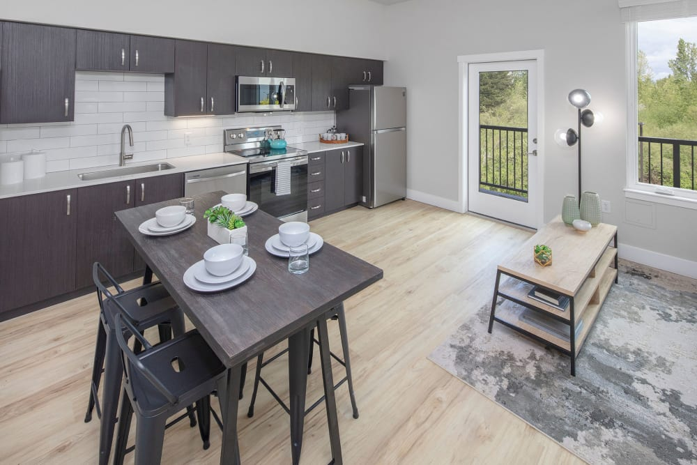 Model living room and kitchen at Brookside Apartments in Gresham, OR