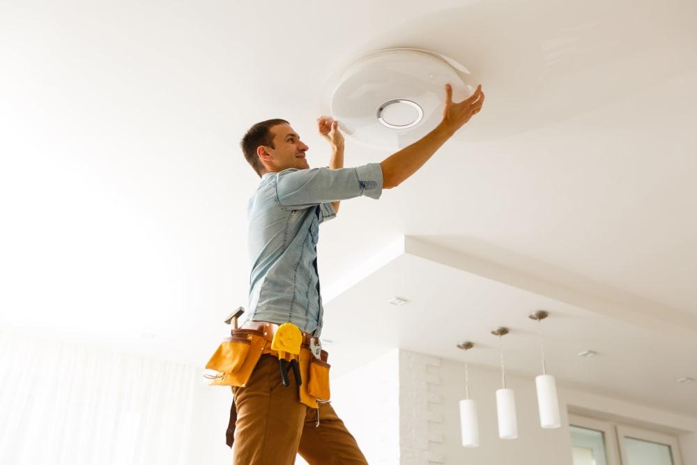Team member replacing a light bulb near CWS Apartment Homes in Austin, Texas