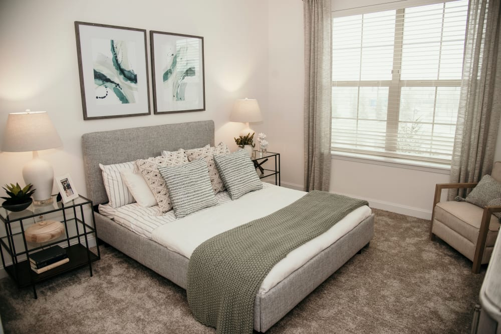 Bright carpeted bedroom at The 450 in Lombard, Illinois