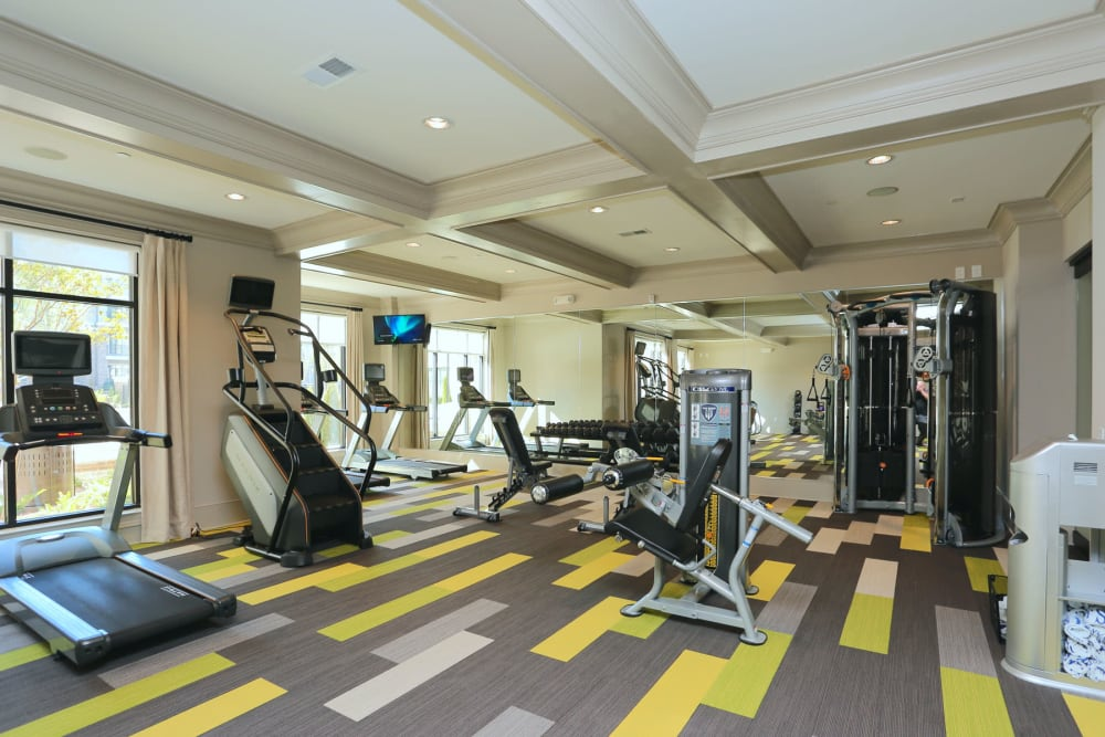 Exercise machines and strength training equipment in the fitness center at 2370 Main at Sugarloaf in Duluth, Georgia