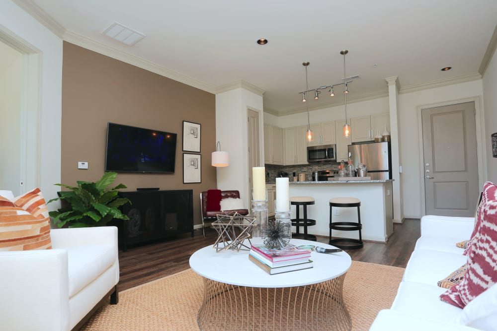 Modern furnishings and an accent wall in a model home's living area at 2370 Main at Sugarloaf in Duluth, Georgia
