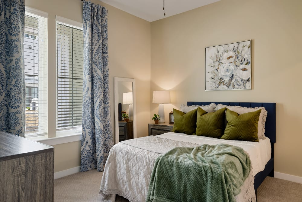 A cozy bedroom at The Claiborne at Brickyard Crossing in Summerville, South Carolina