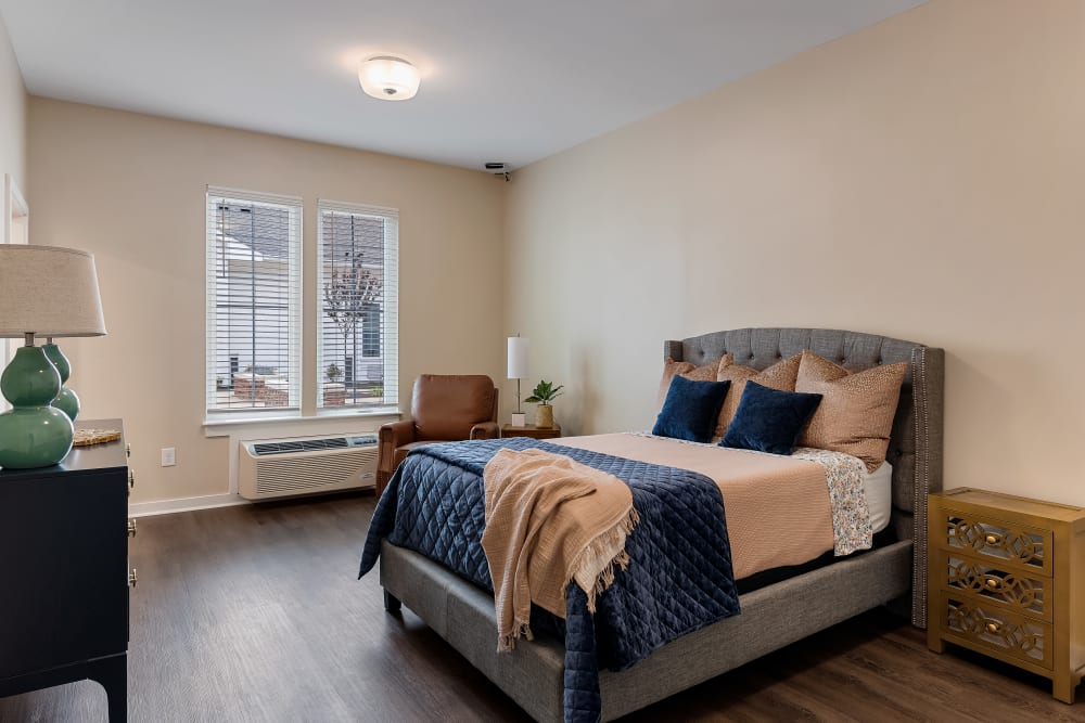 A bedroom with hardwood floors at The Claiborne at Brickyard Crossing in Summerville, South Carolina