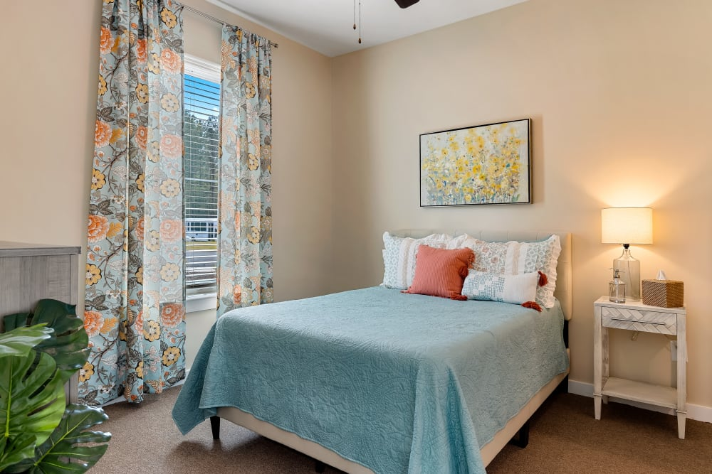 A resident bedroom at The Claiborne at Brickyard Crossing in Summerville, South Carolina.