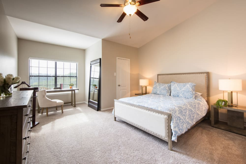 Modern-style, spacious bedroom at Marquis at Treetops in Austin, Texas