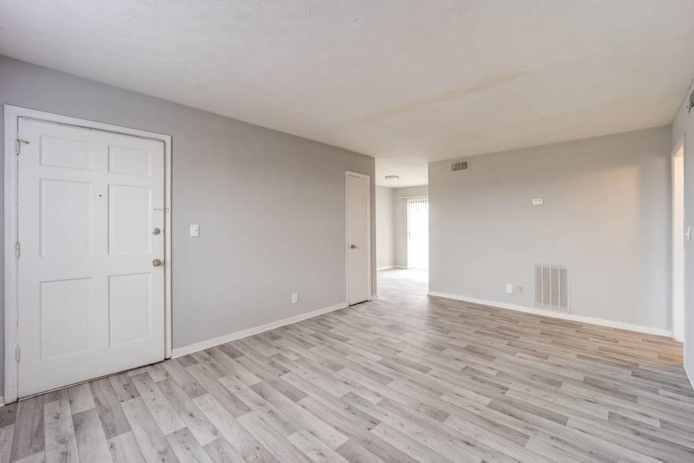 Hardwood-style flooring in the living area of an apartment at Sedgefield in Marietta, Georgia