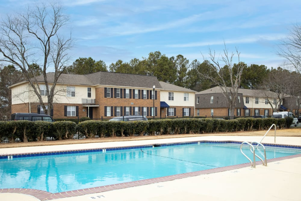 View of resident buildings from the swimming pool area at Sedgefield in Marietta, Georgia