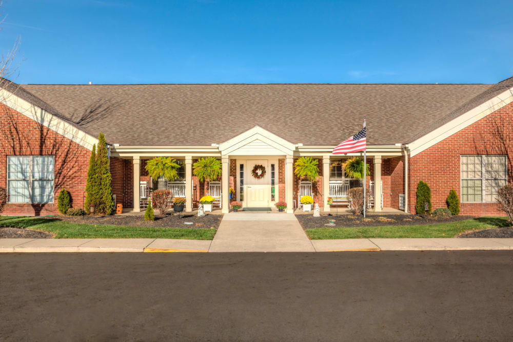 Sunny entryway to upscale senior living facility at Carriage Court of Washington Court House in Washington Court House, Ohio