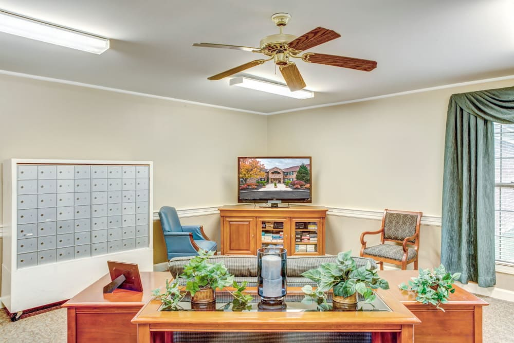 Sitting area with wood accents and television set at Carriage Court of Lancaster in Lancaster, Ohio