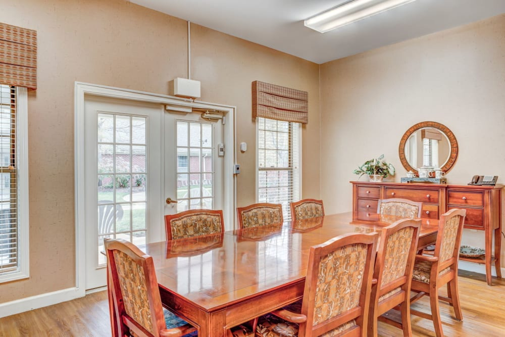 Brightly lit dining area with wood accents at Carriage Court of Lancaster in Lancaster, Ohio
