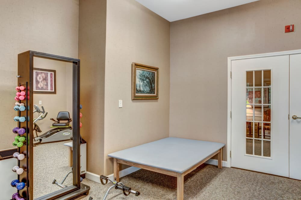 Fully equipped gym complete with weight set at Carriage Court of Lancaster in Lancaster, Ohio