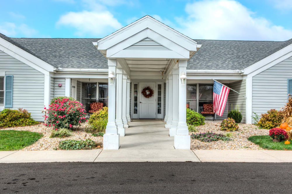 Front entrance on a sunny day to upscale senior living facility at Carriage Court of Grove City in Grove City, Ohio
