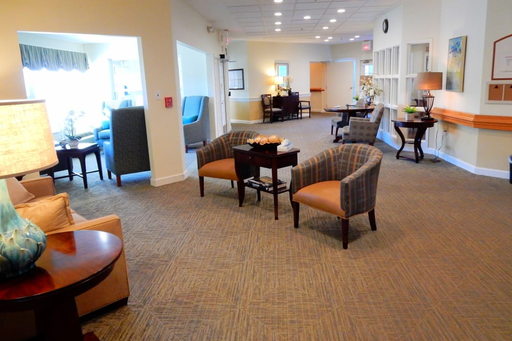Elegant sitting area with armchairs and bright lighting at Carriage Court of Grove City in Grove City, Ohio