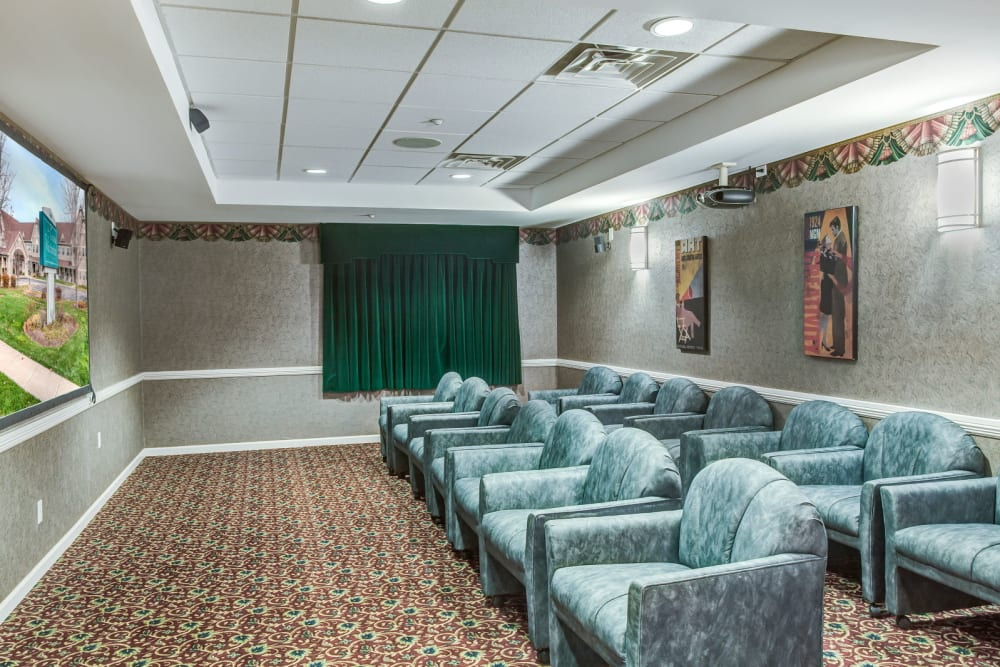 Deluxe movie room with comfortable seating at Grand Victorian of Sycamore in Sycamore, Illinois