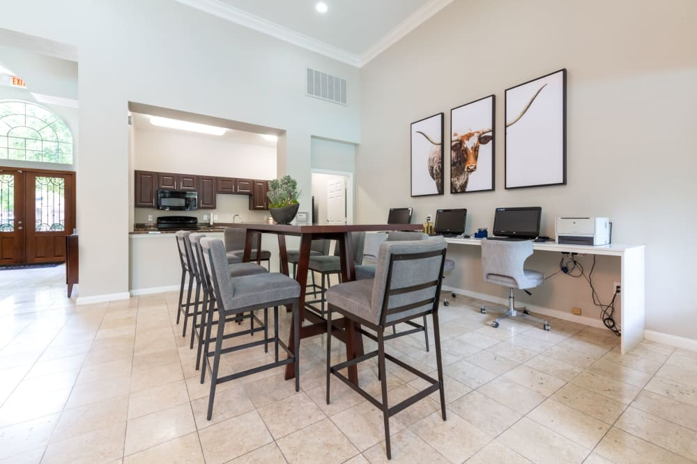 Large table and clubhouse kitchen at at Marquis at Westchase in Houston, Texas
