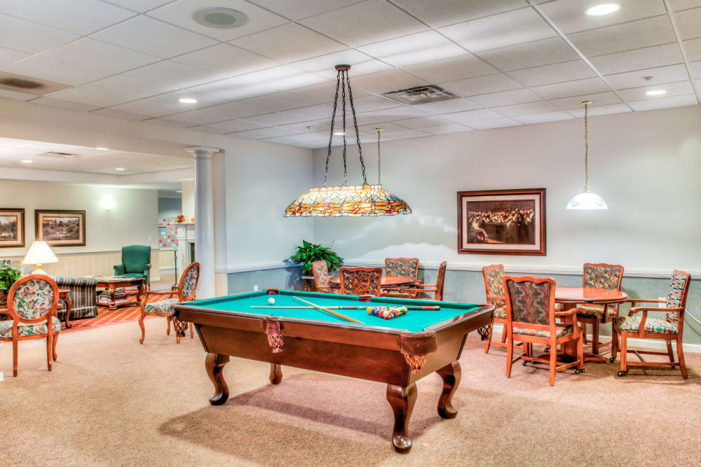 Activity and game room complete with large pool table at Grand Victorian of Sycamore in Sycamore, Illinois