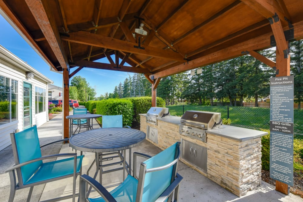 The outdoor covered barbecue area at The Landings at Morrison Apartments in Gresham, Oregon