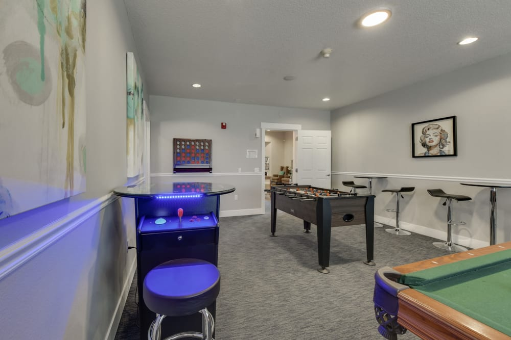Clubhouse  game room amenities include a pool table foosball and more at The Landings at Morrison Apartments in Gresham, Oregon
