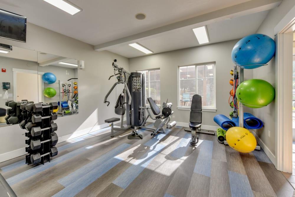 Clean, modern community gym at The Landings at Morrison Apartments in Gresham, Oregon