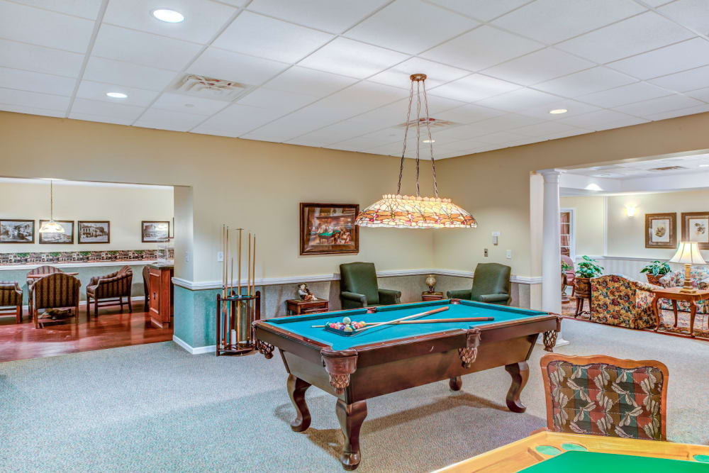 Game room complete with pool tables at Grand Victorian of Rockford in Rockford, Illinois