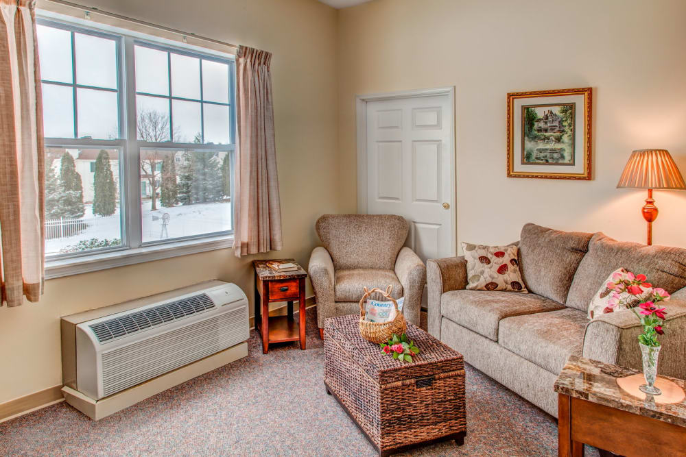 Cozy apartment with comfortable seating at Grand Victorian of Rockford in Rockford, Illinois