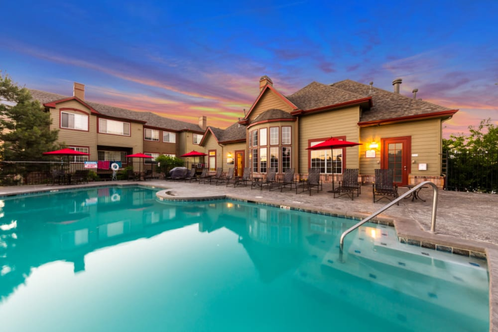 Resort-style heated swimming pool with spa and golf course views at The Links at Plum Creek in Castle Rock, Colorado