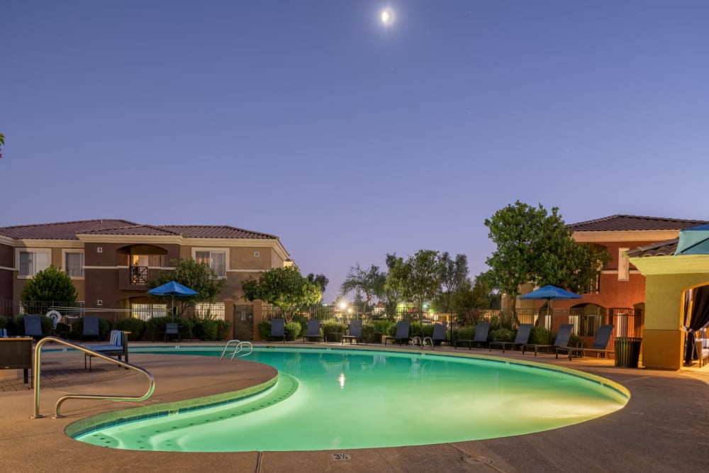 Lighted pool at sunset at Alante at the Islands in Chandler, Arizona