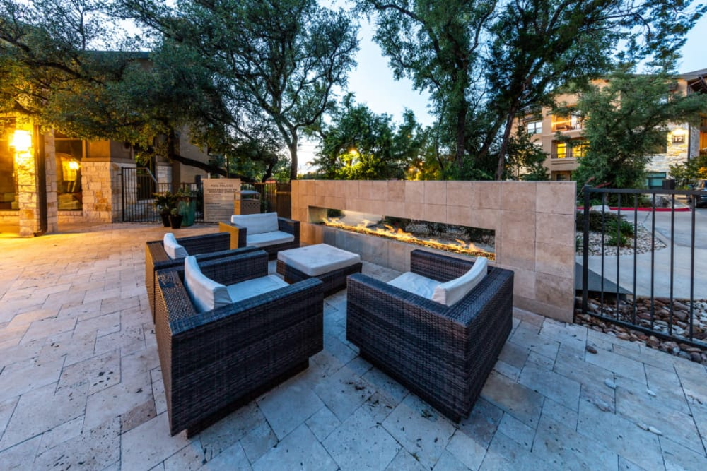 Outdoor seating with fireplace at sunset at Marquis at Barton Trails in Austin, Texas
