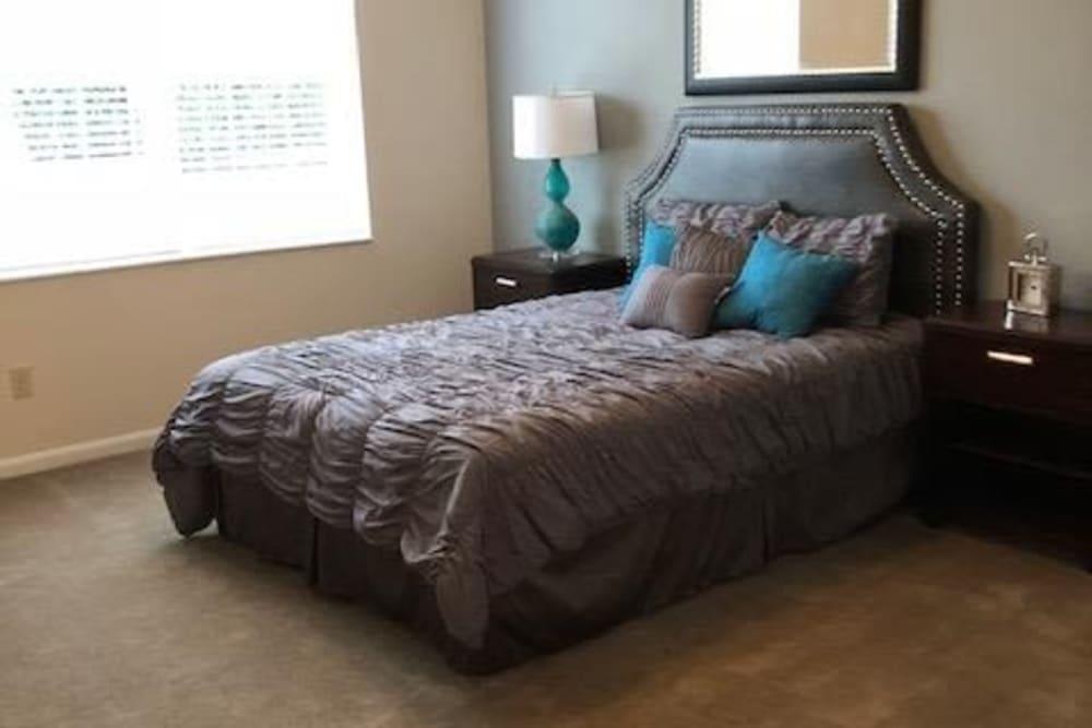 Well lit bedroom at Aspen Pines Apartment Homes in Wilder, Kentucky