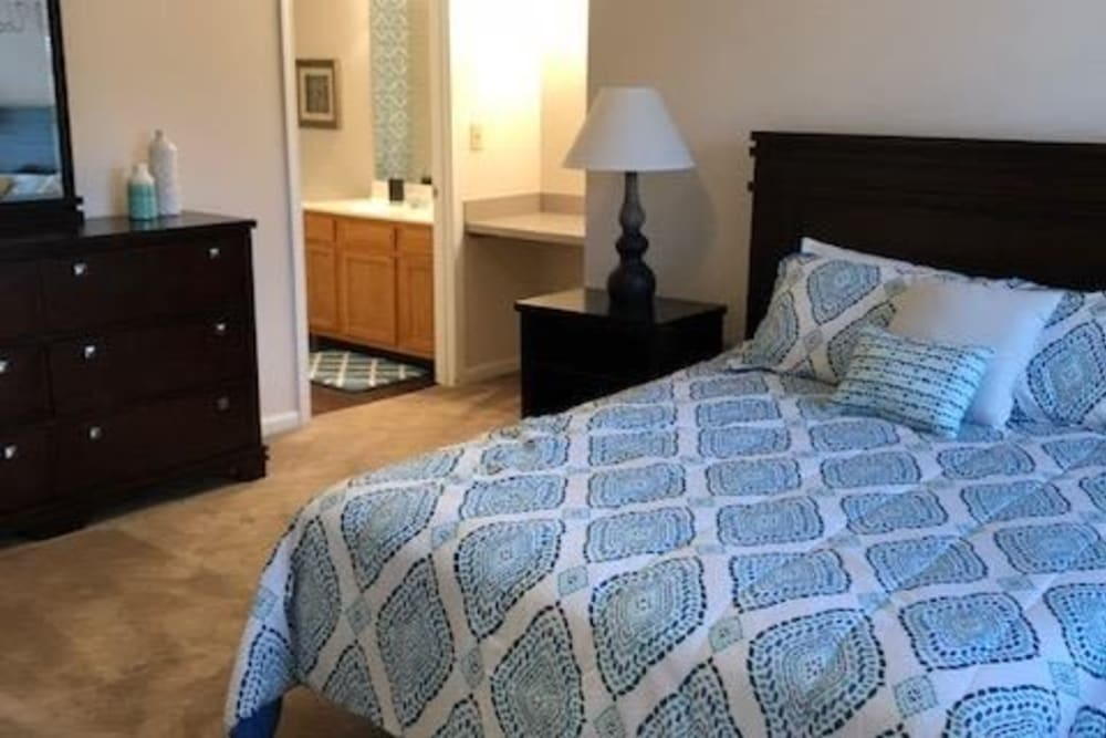Spacious carpeted bedroom at Aspen Pines Apartment Homes in Wilder, Kentucky