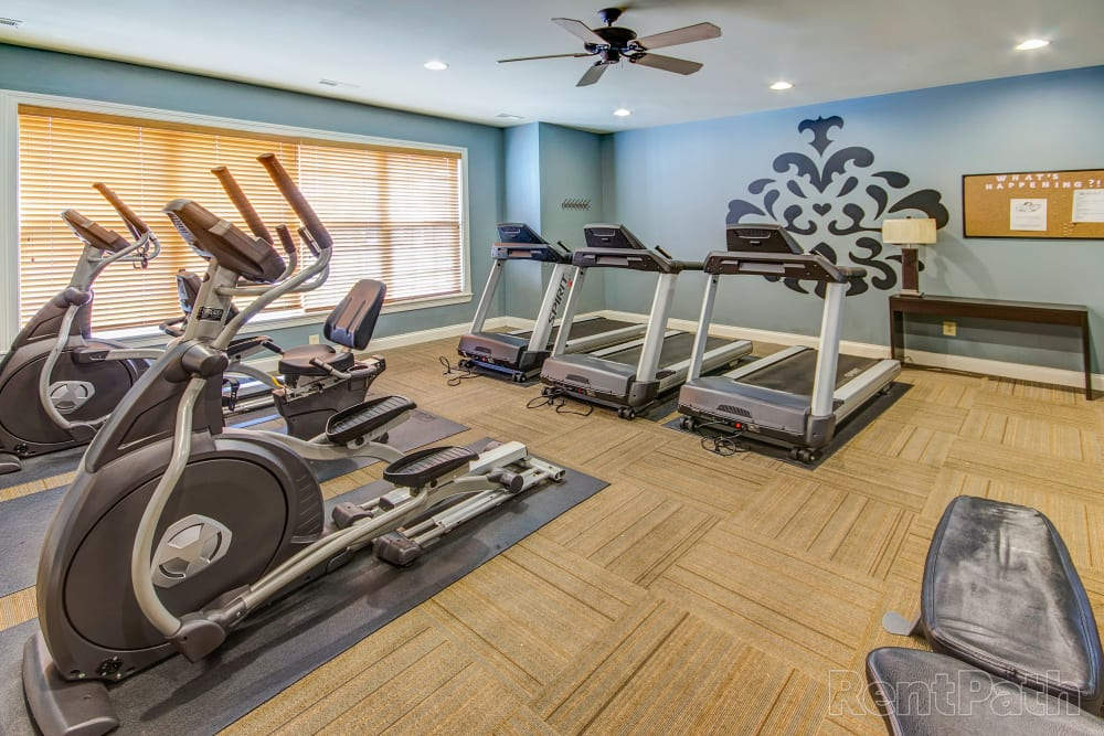 Get a workout in at the full sized fitness center at Aspen Pines Apartment Homes in Wilder, Kentucky