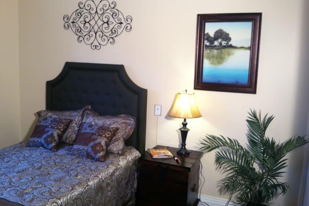 Sleek bedroom furniture at senior living apartment at Brookstone Estates of Charleston in Charleston, Illinois.