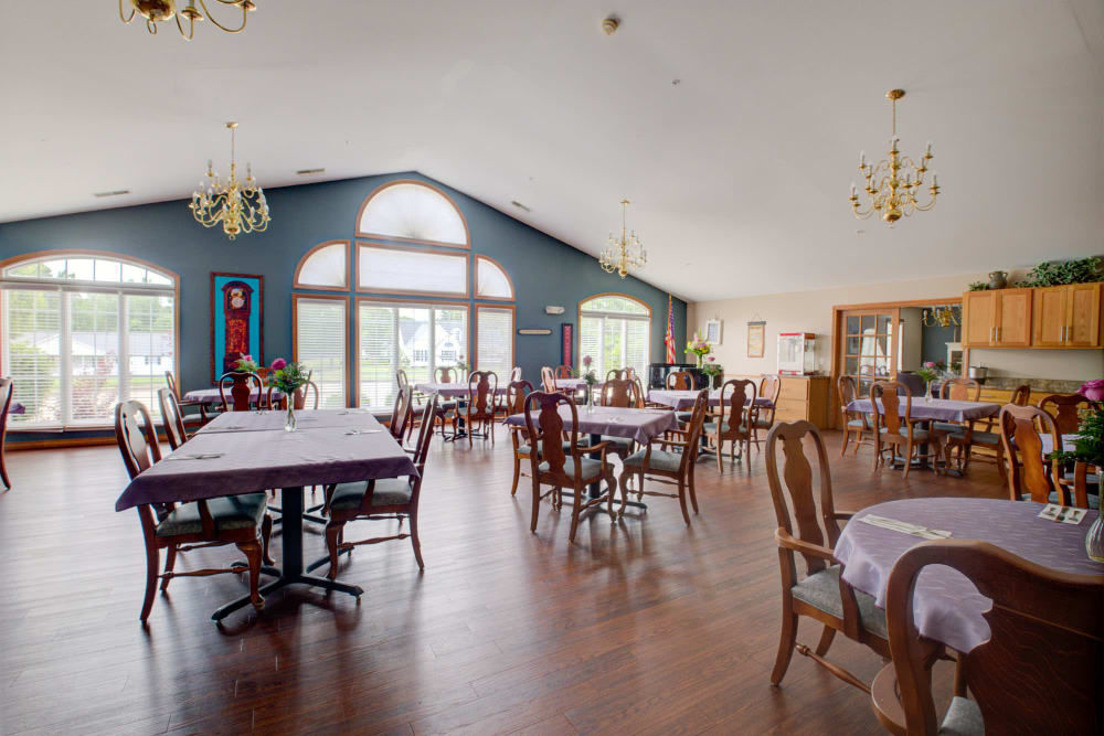 Elegant dinning with wood accents and chandeliers at Brookstone Estates of Vandalia in Vandalia, Illinois