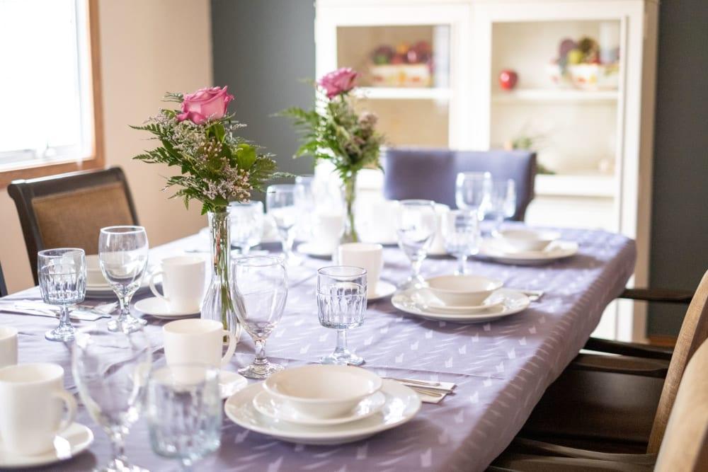 Elegant place settings at dining table at Brookstone Estates of Vandalia in Vandalia, Illinois