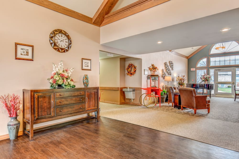 Sunny and spacious common area with wood accents at Brookstone Estates of Tuscola in Tuscola, Illinois