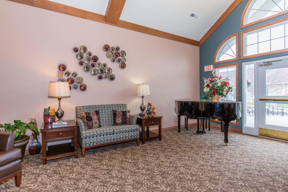 Cozy sitting room complete with piano at Brookstone Estates of Tuscola in Tuscola, Illinois