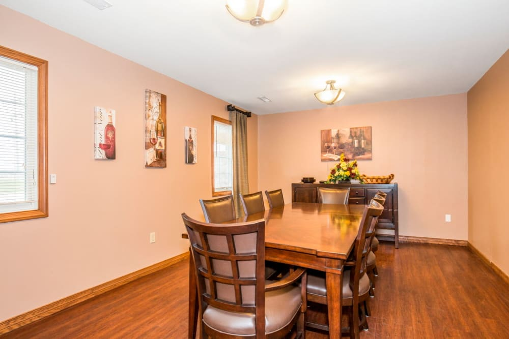 Dining area with wood accents at Brookstone Estates of Tuscola in Tuscola, Illinois