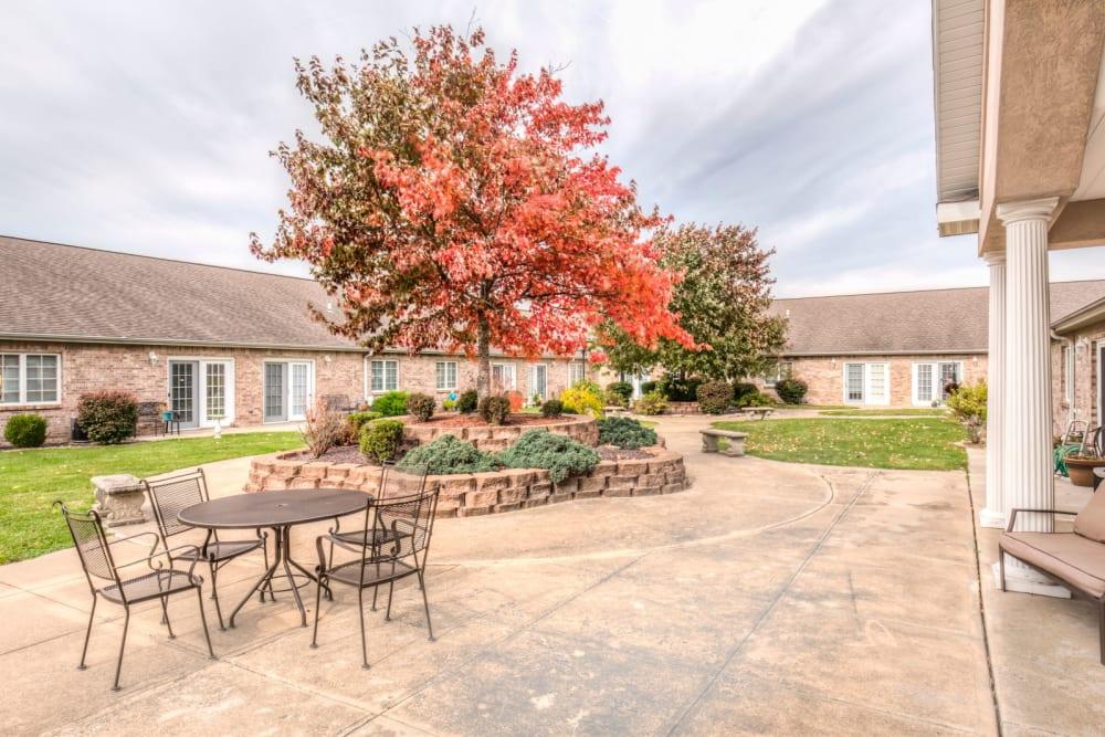 Inviting back patio with fall foliage at Brookstone Estates of Effingham in Effingham, Illinois.