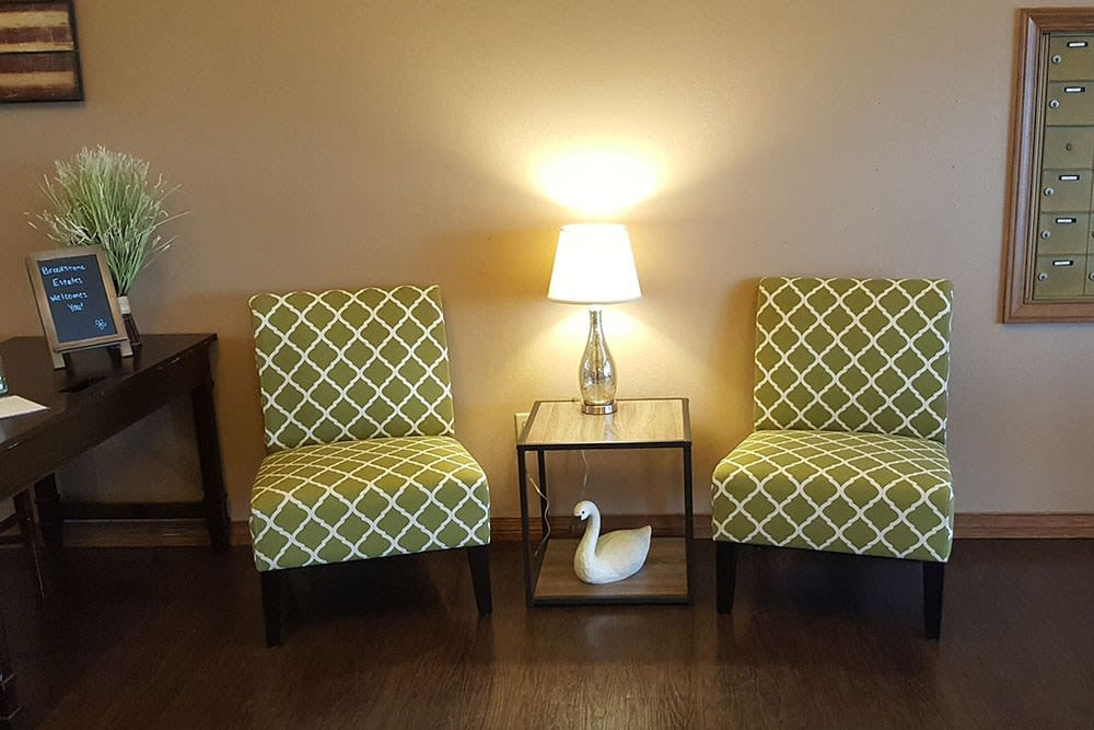 Cheerful lounge seating with bright lamp at Brookstone Estates of Robinson in Robinson, Illinois